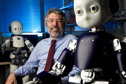 Giulio Sandini with two iCub humanoid robots