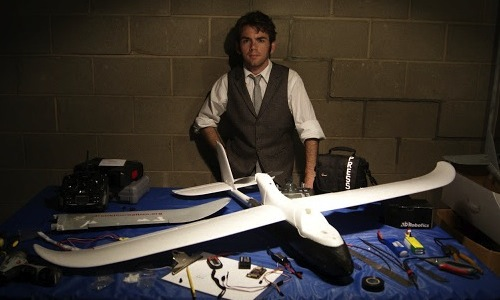 photo of Matthew Schroyer with fixed-wing drone
